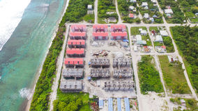 Aerial View of Red Gray Structures Near Ocean at Daytime Royalty Free Stock Photography
