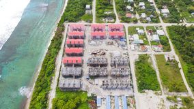 Aerial View of Red Gray Structures Near Ocean at Daytime Stock Photo