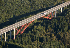 Aerial view : Red highway bridge crossing a forest Royalty Free Stock Images