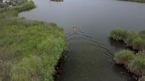 Kayak sailing on the river stock video footage