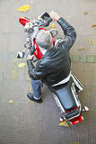 Aerial view red motorcycle rider royalty free stock photography