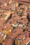 Aerial view of red tiled rooftops and ancient towers in historical center of Bologna Stock Images