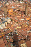 Aerial view of red tiled rooftops and ancient towers in historical center of Bologna Stock Image