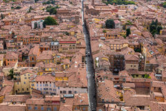 Aerial view of red tiled rooftops and ancient towers in historical center of Bologna Royalty Free Stock Images