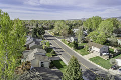 Aerial view of redintial street in Fort Collins, Colorado. FORT COLLINS, CO, USA - APRIL 25, 2015: Aerial view of a street in Fort Collins, a typical residential Royalty Free Stock Image