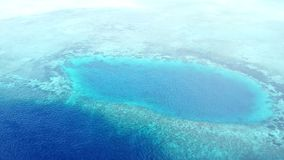 Aerial View of Reef and Blue Hole in Wakatobi National Park. Aerial view of a coral reef and blue hole in Wakatobi National Park in Indonesia. This region stock video