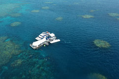 Aerial view of reef with marine diving platform and boats at the Royalty Free Stock Photography