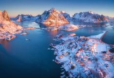 Aerial view of Reine at sunrise in winter in Norway. Top view Stock Photos
