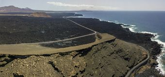 Aerial view of reliefs, volcanoes and lava fields in Lanzarote island, Canary Islands, Spain royalty free stock images