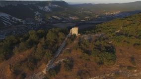 Aerial view on remains of an ancient observation tower in the mountains. Shot. Watch tower of the ancient city in the. Aerial view on remains of an ancient royalty free stock images