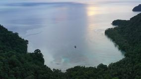Aerial View of Remote Bay in Papua New Guinea. A bird`s eye view of the remote island of New Ireland in Papua New Guinea shows an idyllic bay. This remote area stock footage
