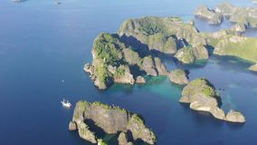 Aerial view of remote Limestone Islands and Ship in Raja Ampat stock video