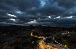 Urbino, night view. Aerial view of renaissance town Urbino Marche Italy. Night view with a dramatic dark sky before a thunderstorm Stock Photography