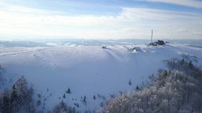 Flight over the research station on top of Carpathian mountains covered with snow. Clear frosty weather. Aerial view on the research station on top of Carpathian stock footage