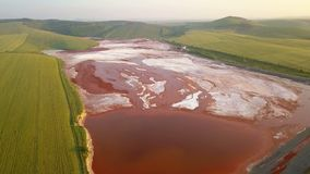 Aerial view of a reservoir full of red toxic sludge stock video footage