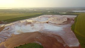 Aerial view of a reservoir full of red toxic sludge stock video