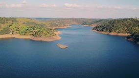 Aerial View Reservoir near Dam stock footage