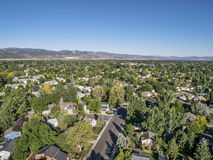 Aerial view of residential area in Fort Collins. Colorado, with foothills of Rocky Mountains  in background from a low flying drone, late summer Stock Photo