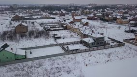 Aerial view on residential area with private houses in winter stock footage