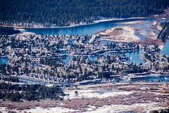 Aerial view of a residential area in South Lake Tahoe, with houses built on the shores of man made canals, California; sunny. Winter day stock photos