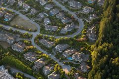 Aerial View of Residential Homes. Aerial view of the big luxury homes on the hill during a vibrant sunny summer day. Taken in West Vancouver, British Columbia royalty free stock images