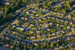 Aerial View of Residential Homes. Aerial view of the residential homes during a vibrant sunny summer day. Taken in North Vancouver, British Columbia, Canada royalty free stock photos