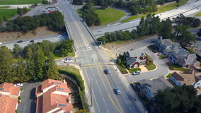 Aerial view of residential houses and road interchange stock footage