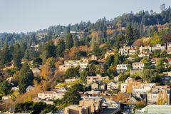 Aerial view of residential neighborhood built on a hill on a sunny autumn day royalty free stock photography