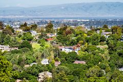 Aerial view of residential neighborhood; San Francisco bay visible in the background; Redwood City, California royalty free stock image