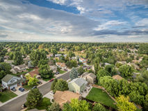 Aerial view of residential street in Fort Collins, Colorado. FORT COLLINS, CO, USA - AUGUST 27, 2015: Aerial view of Fort Collins at late summer, a typical Royalty Free Stock Photos