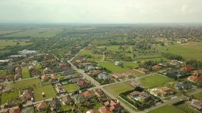 Suburbs from above. Aerial view of a residential streets with houses stock video