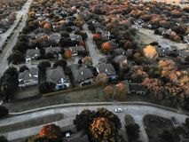 Free Aerial View Residential Subdivision Near Expressway With Colorful Leaves Autumn Sunset In USA Stock Photos - 132928453
