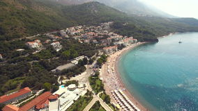 Aerial view of resort area in with vacationers. Aerial view of resort area in Montenegro stock footage