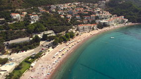 Aerial view of resort area in with vacationers. Aerial view of resort area in Montenegro stock video