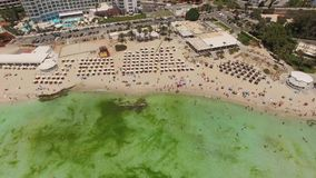 Aerial view of resort area with vacationers. Aerial view of Nissi beach with vacationers stock video