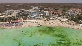 Aerial view of resort area with vacationers. Aerial view of Nissi beach with vacationers stock video footage