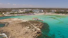 Aerial view of resort area with vacationers. Aerial view of Nissi beach with vacationers stock footage