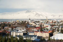 Aerial view of Reykjavik from Perlan, snow capped mountains during winter sunset, Iceland Stock Photos