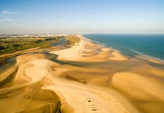 Aerial view from the Ria Formosa River and sea. Aerial view from the ria formosa river paralel to the sea with amazing and long extension beaches in Algarve Stock Image