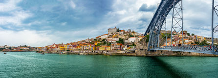 Panorama view of Ribeira and at Dom Luis Bridge at Oporto, Portugal royalty free stock photo
