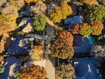 Aerial view rich houses with swimming pool in autumn near Dallas, Texas. Top view upscale neighborhood with luxury house and swimming pools surround by colorful royalty free stock image