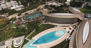 Aerial view of rich Mriya resort. Swimming pool, tennis courts, helicopter pad stock video