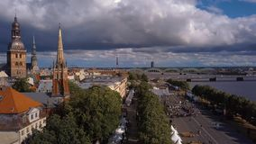 Aerial view of the Riga old town. Celebrating `Jani` with people dancing and singing in the center of Riga stock footage