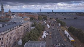 Aerial view of the Riga old town. Celebrating `Jani` with people dancing and singing in the center of Riga stock video