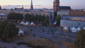 Aerial view of the Riga old town. Celebrating `Jani` with people dancing and singing in the center of Riga stock video footage