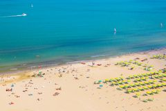 Aerial view of Rimini beach with people and blue water. Summer vacation concept. Aerial view of Rimini beach with people and blue water. Summer vacation concept royalty free stock photography