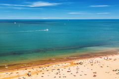 Aerial view of Rimini beach with people, ships and blue sky. Summer vacation concept. Aerial view of Rimini beach with people, ships and blue sky. Summer royalty free stock image