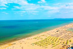 Aerial view of Rimini beach with people, ships and blue sky. Summer vacation concept. Aerial view of Rimini beach with people, ships and blue sky. Summer royalty free stock photos
