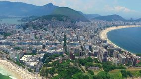 Aerial view of Rio de Janeiro and the Atlantic Ocean with mountains stock video