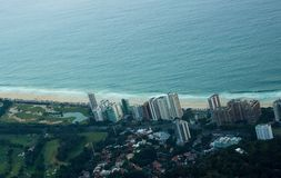 Aerial view of Rio de Janeiro beach capturing sea, sand, building and forest. Wallpaper Royalty Free Stock Photography